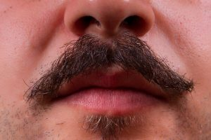What are the stages of mustache growth